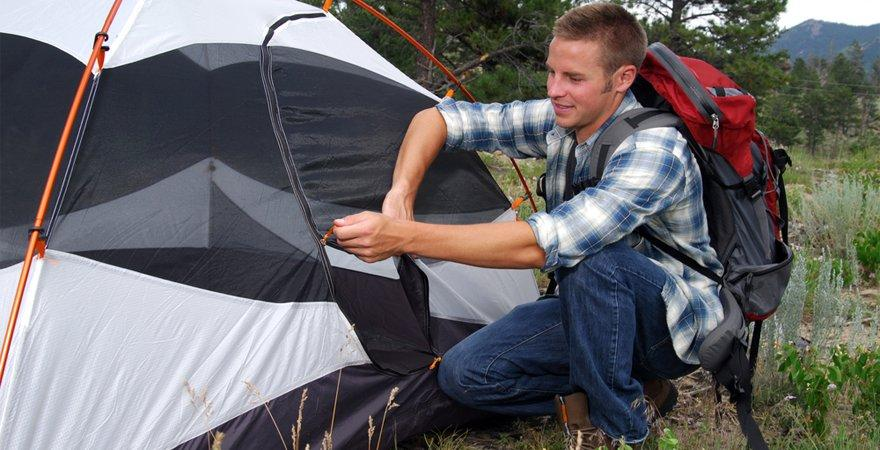 zipping up a tent